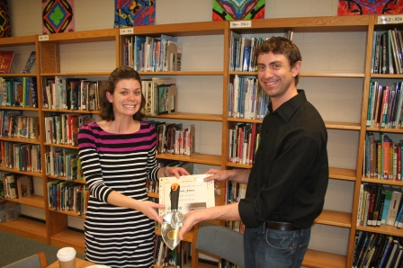 """Joe Muellenberg, Dane County Extetension Nutrition and Horticulture Programs, presents a """"Golden Trowel"""" award in appreciation to Nicole Nelson, GROW Pilot coordinator at MMSD, for all of her great work in the pilot's first year."""